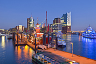 Germany, Hamburg, view to Hanseatic Trade Center and Elbphilharmonie seen from Niederhafen in the evening - RJF00653