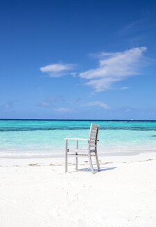 Maledives,South Male Atoll, Wooden chair at beach - JLRF00089