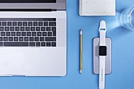 Various electronic devices, personal organizer, pencil and glass of water on blue ground - MMAF00033