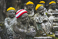 Japan, Miyajima, Daisho-In Temple, stone buddhas with crocheted skullcaps - KEBF00485