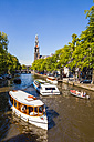 Netherlands, Amsterdam, view to Westerkerk with tourboats on Prinsengracht in the foreground - WD03910