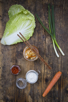 Glass of Kimchi and ingredients on dark wood - LVF05884