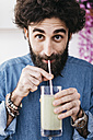 Portrait of bearded man drinking green smoothie - JRFF01234