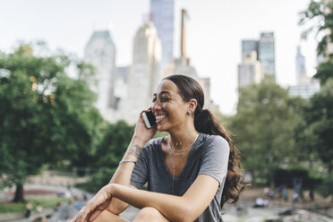 USA, Manhattan, portrait of young woman on the phone in Central Park - GIOF02001