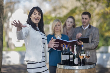 Wine saleswoman with group of clients outdoors - ZEF12878