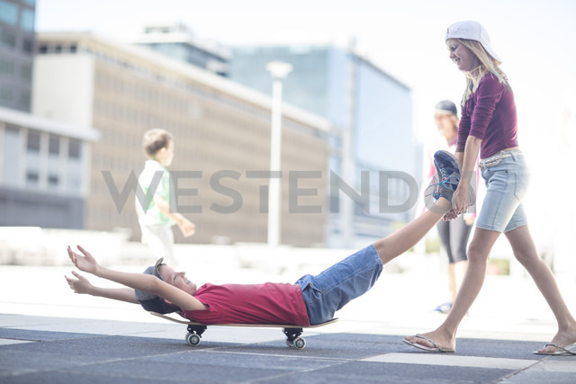 Kids skateboarding in the street - ZEF12905