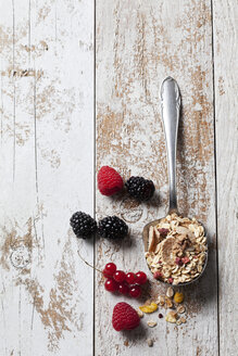 Server with granola and various wild berries on wood - CSF27920