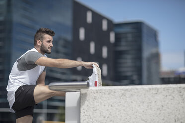 Athlete stretching in the city - ZEF12913