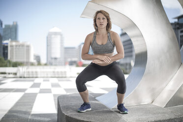 Young woman exercising in the city - ZEF12940