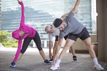 Three athletes doing gymnastics in the city - ZEF12943
