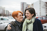 Happy adult daughter with mother in the city - ZEDF00524