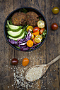 Lunch bowl of leaf salad, red cabbage, avocado, tomatoes and quinoa fritters - LVF05897