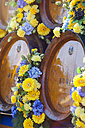 Germany, Bavaria, Munich, wooden barrels on cart at Oktoberfest - MMAF00038