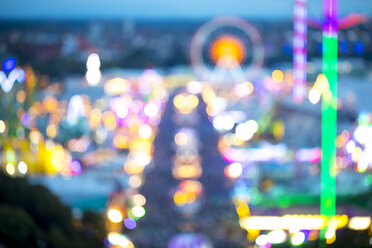 Germany, Munich, blurred view to lighted Oktoberfest - MMAF00056