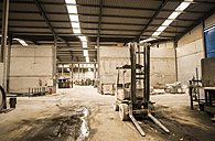 Forklift in factory messy hall - JASF01554
