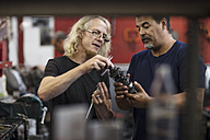 Two mechanics discussing in workshop - ZEF13011