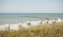 Germany, Hiddensee, view to beach with hooded beach chairs - LHF00517