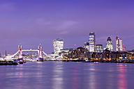 UK, London, skyline with River Thames and Tower Bridge at blue hour - BRF01421