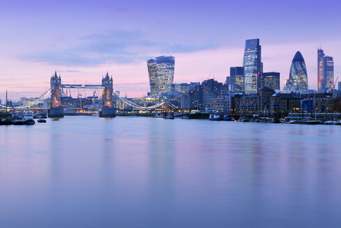 UK, London, skyline with River Thames and Tower Bridge at dusk - BRF01433