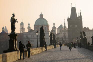 Czechia, Prague, Old town, Charles Bridge and Old Town Bridge Tower at sunset - DSG01513