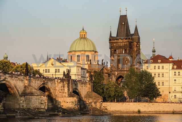 Czechia, Prague, Old town, Charles Bridge, Church of St Francis and Old Town Bridge Tower in the evening - CSTF01310