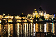 Czechia, Prague, view to lighted Charles Bridge and Old Town Bridge Tower at night - CSTF01313