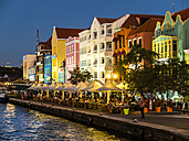 Curacao, Willemstad, Punda, colorful houses at waterfront promenade in the evening - AMF05308
