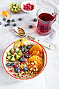 Superfood breakfast with porridge, amaranth, various fruits and pistachios - SARF03228