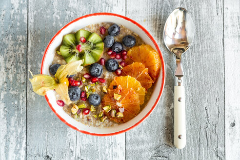 Superfood breakfast with porridge, amaranth, various fruits and pistachios - SARF03231