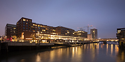 Germany, Hamburg, HafenCity, Elbarkaden at Magdeburger Hafen by twilight - WIF03406