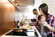 Young couple cooking together at home - VABF01213