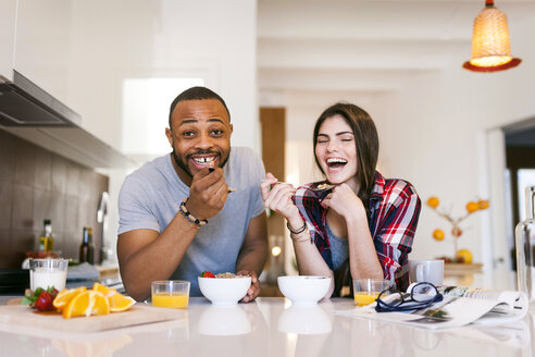 Young couple having breakfast in the kitchen - VABF01222