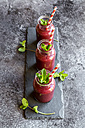 Beet root smoothie in glasses garnished with fresh mint - SARF03244
