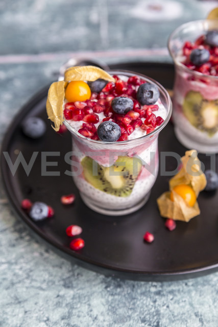 Glass of chia pudding with several fruits - SARF03253