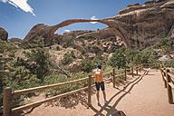 USA, Utah, Arches National Park, tourist at Landscape Arch - EPF00385