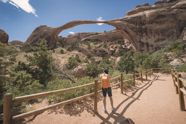 USA, Utah, Arches National Park, tourist at Landscape Arch - EPF00385