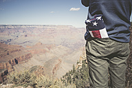 USA, Grand Canyon, man with American Flag in his pocket, partial view - EPF00387