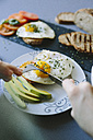 Breakfast with eggs, avocado, bread and tomatoes - GIOF02157