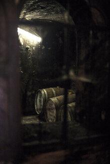 Old wooden barrels at a whisky distillery - ZEF13141