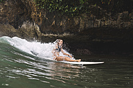 Indonesia, Java, happy woman surfing - KNTF00684