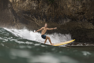 Indonesia, Java, man surfing - KNTF00696