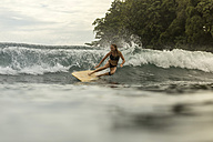 Indonesia, Java, happy woman surfing - KNTF00702