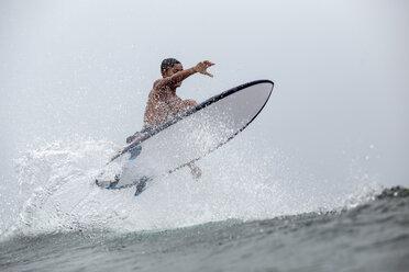 Indonesia, Java, man surfing - KNTF00717