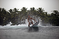 Indonesia, Java, surfer on a wave - KNTF00723