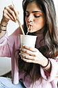 Young woman eating Chinese noodles - VABF01244
