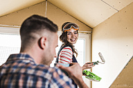 Young couple renovating their new home - UUF10100