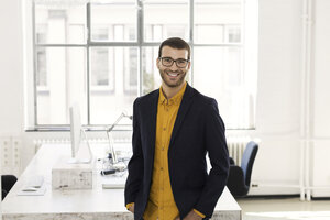Portrait of a young businessman in his office - SBOF00325