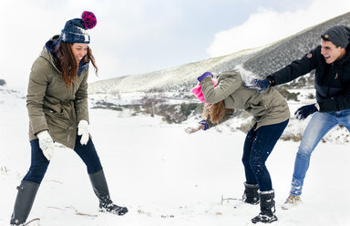 Friens having a snowball fight in the snow - MGOF03036
