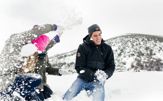 Friens having a snowball fight in the snow - MGOF03048