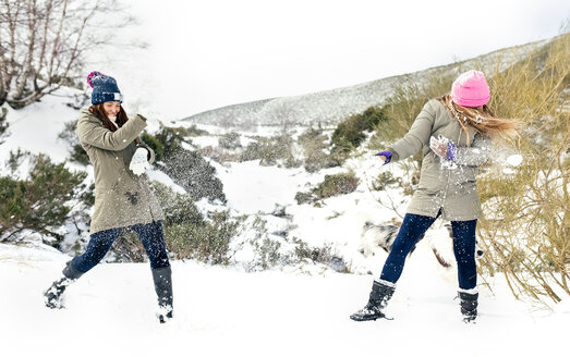 Friens having a snowball fight in the snow - MGOF03060
